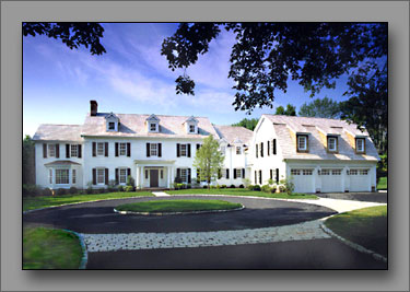 A colonial manor with Greek Revival influences.
