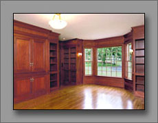 Fully paneled library in mahogany with a hand-rubbed finish.